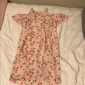 Floral dress that shows shoulders.